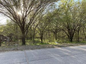 Vacant 150 x 140 Lot | Wooded | Zoned Residential | Caldwell KS