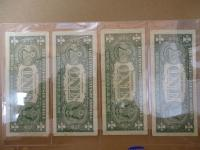 (4)1957 One Dollar Silver Certificates- in sleeve