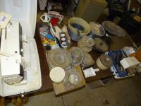 Singer sewing machine in cabinet, dishes, more
