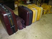 2 sets luggage (brown & yellow), under table