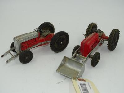 "2 Tootsie Toys tractors, 1 w/front loader (8""), 1 w/out (6"")"