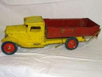 "Buddy ""L"" red & yellow metal dump truck, dump lever works, some rust, 19"""