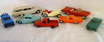 Plastic cars: Turquoise 55 Chevy; 1962 Country Sedan; 1961 red convertible; orange Chevy; green 1969 Barracuda; ivory CDY 923; blue Datsun pickup; red Volkswagen pickup