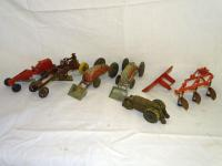 Cast iron road grader w/man on seat; 2 tractors w/front loaders; 3 bottom plow; front blade, hood