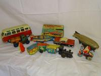 Cragston friction car w/outboard motorboat & trailer, orig box; Marx windup tin train; Marx tin friction Aero Oil Company truck; battery operated Volkswagen van w/driver; windup tin airplane; tin litho windup toys(2)