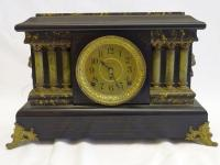 "Seth Thomas Adamantine clock, wooden base, lions on side are metal, plastic top, handwritten inside ""Dec 25/14"", pendulum, 18"" W x 11"" T x 7"" D"