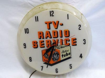 "DuaLite ""GE TV-Radio Service""plastic electric clock, clock works, doesn't light up (probably needs bulbs), 17"" Diam"
