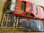 2 remote control cars (unknown if work): Fiero, appears complete, racing stripes loose; '57 Chevy, appears in good condition