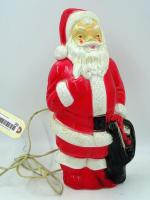 "Vintage 1968 Empire Plastic electrified Santa Claus, fair skin, red cheeks & tongue, black bag, 13"", works"