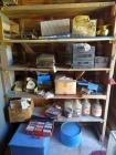 All items on NW corner shelf incl old dial telephones, cassette tapes, gallon jugs