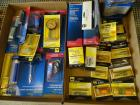 2 boxes Tire Repair Kits & Couplers on top shelf