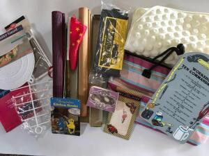 Unopened Assortment of Items, Including Cheese Grater, Shower Mat, Tote, Chinese Scrolls, Silk, Workshop Tin Sign and More