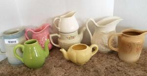 Ceramic Pitchers and Tea Pots of Various Shapes, Sizes, and Colors