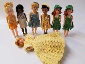 7 plastic dolls w/knitted outfits